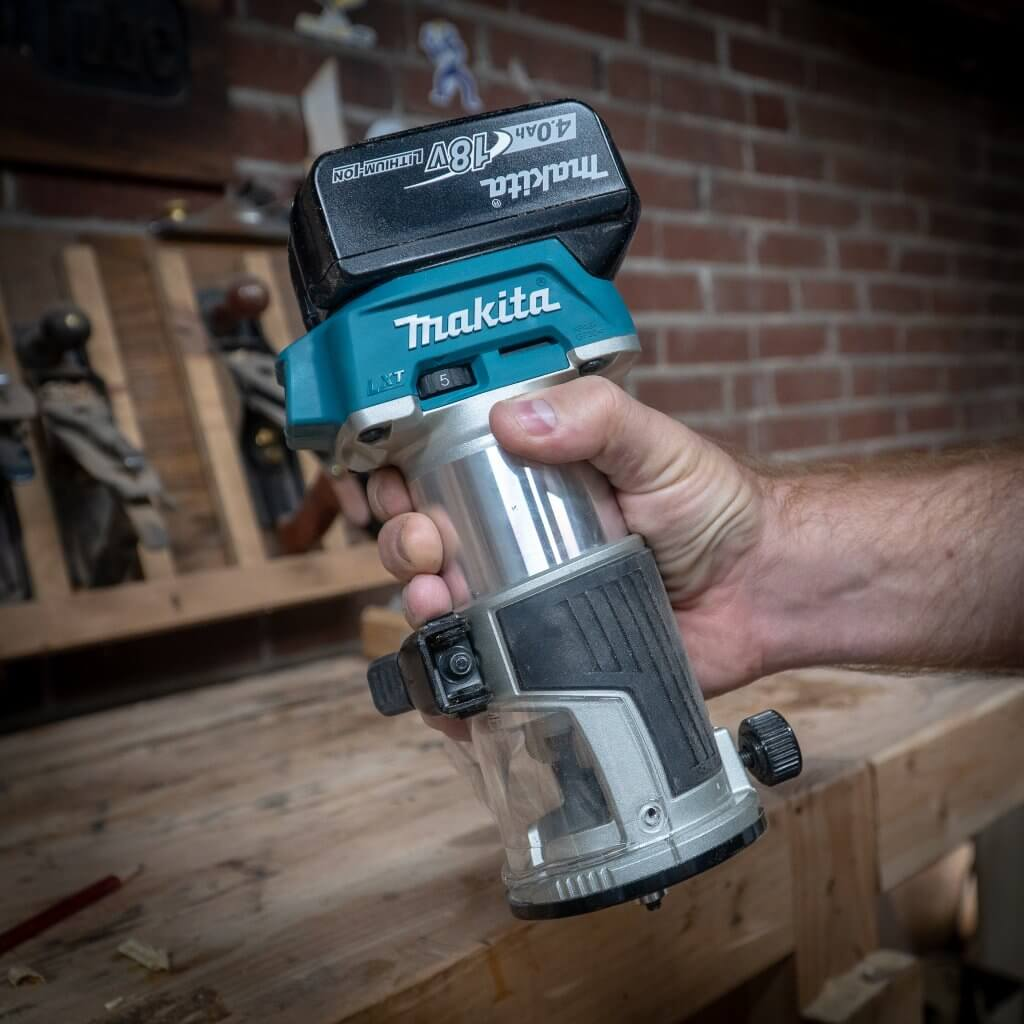 Makita 18-Volt LXT Lithium-Ion Brushless Cordless Variable Speed Compact Router in hand